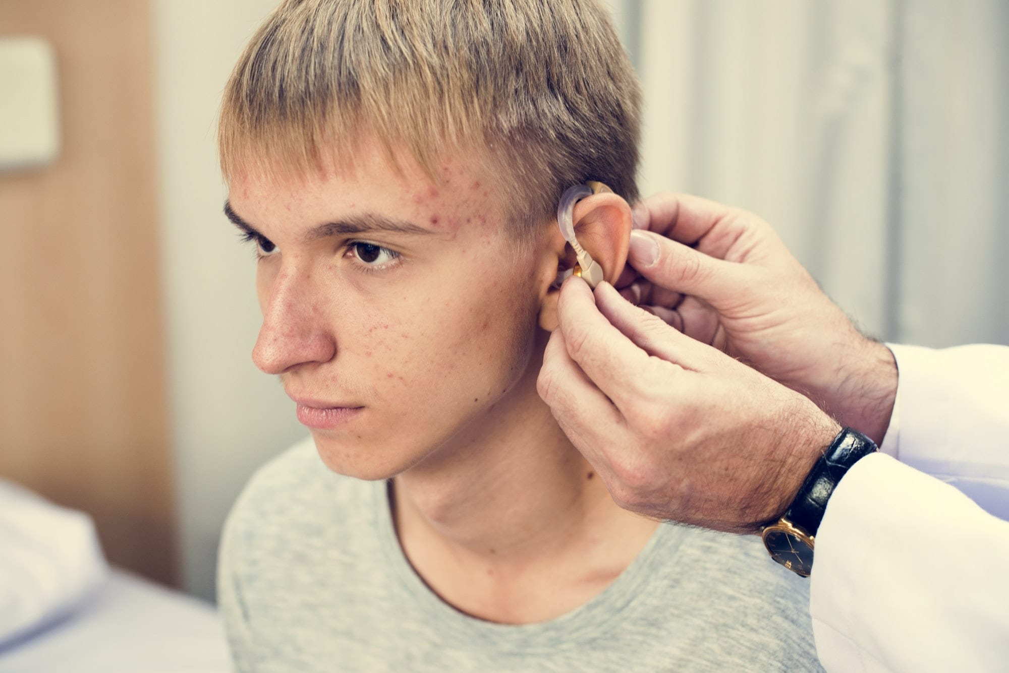 Young man with hearing aid
